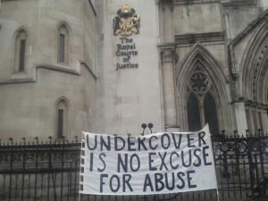 'Undercover is no Excuse for Abuse' banner at the High Court