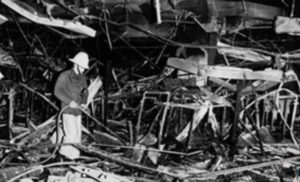 Firefighter in the wreckage of Debenhams Luton store after 1987 incendiary attack